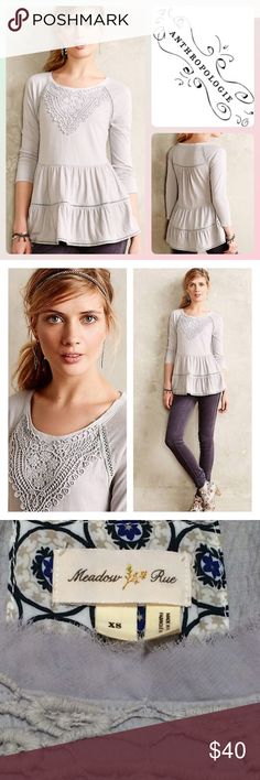 """Anthro Crochet Tiered Tunic Beautiful light gray top by Anthropologie (Meadow Rue). Gorgeous crochet detail at neckline. Semi fitted through bodice and then flows out in the bottom. Very detailed and pretty. In excellent gently-loved condition. True to size XS but also very stretchy. Bust measures 17"""" across unstretched. Length is 26"""". Looks amazing with skinny jeans or leggings. Anthropologie Tops Tunics"""