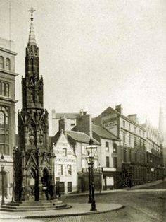 Walter Fountain, Lister Gate, Nottingham, c 1910. The Walter Fountain was designed by a Mr Sutton in a Victorian Gothic style in 1866 and commissioned by Mr John Walter, son of John Walter of Bear-Wood, at a cost of £1,000. John Walter was a proprietor of The Times and in 1841 he stood as a Conservative candidate for Nottingham. The fountain was demolished in the 1950s when the road was widened. It was located at the junction of Greyfriar Gate, Lister Gate and Carrington Street. Nottingham City, Black Hood, Victorian Gothic, Family History, Old Photos, Walks, 1950s, The Past, England