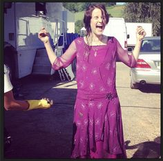 Lady Mary seemingly having a fun time having mud thrown on her: