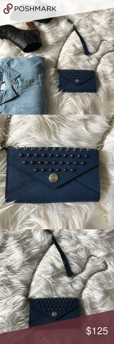 "Rebecca Minkoff Studded Chain Clutch Rebecca Minkoff Studded Chain Clutch.  One of my favorite Rebecca Minkoff pieces yet.  Gorgeous navy color with stud detail.  Love the versatility, wear as a clutch, use as a wallet or cross body.  Brand new with tags.  Does not have a dust bag.  Measure approximately 6""x4""x1. Rebecca Minkoff Bags Crossbody Bags"