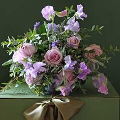 Gorgeous bouquet with english sweet pea flowers, mint, lavender and rosemary.