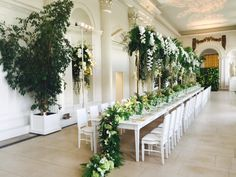 In the Orangery at Kensington Palace, hanging flowers, trailing table decorations and two stunning walls of foliage create a masterpiece.