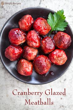 Tender turkey meatballs, browned and then glazed in a cranberry ginger orange glaze. So festive for holiday entertaining! On SimplyRecipes.com