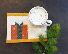 If you can't get enough Christmas sewing projects, here's another one for you. Today I'm going to show you how to make a quick project for the Holidays, a Mug Rug. It's perfect to place your hot chocolate or afternoon tea and can be sewn together quickly in between your family gatherings. #holiday #gift #hostess #quilt #mini #tutorial