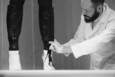 Footwear designer Benjamin John Hall dispersed black dye onto his latest shoe designs with a series of physical processes – including smashing, spraying and squeezing – during a live event at London College of Fashion