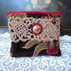 Handmade zipper pouch from woven velvet upholstery fabric with vintage crochet trim and button.