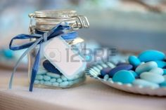 21139722-birth-in-light-blue-candy-container-glass-and-paper-plate.jpg (1350×900)