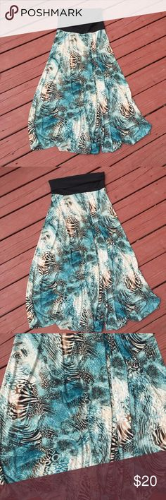 Maxi Skirt Like new maxi skirt or dress. It is very stretchy and can be pulled up over chest or rolled down to be a skirt. Perfect for summer! It measures 40 inches long and waist measures 26 inches. Could easily also fit a medium because of stretch. No flaws! Women in Control Skirts Maxi
