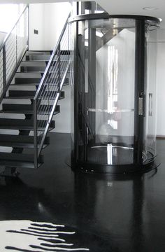 Visilift round glass elevator, a beautiful addition to a modern home.