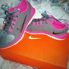 Nike shows Pink and grey. Nike shoes. In good condition. They're clean. Nike Shoes Athletic Shoes