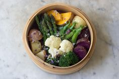 Steaming Vegetables HS: I use a three-tiered bamboo steamer, the sort that is available in most culinary shops.
