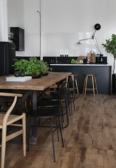 Black kitchen cabinets with white subway tile
