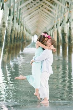 Candid and romantic boho inspired beach engagement photos at the Folly Beach Pier in Charleston, SC… complete with floral crown by Branch Design Studio » by Charleston wedding photographers Aaron and Jillian Photography