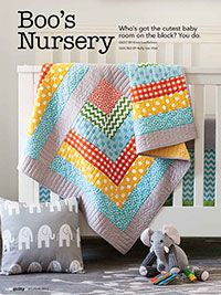 """Boo's Nursery Quilt Digital Pattern    Enjoy the Boo's Nursery quilt digital pattern from Quilty's July August 2013 issue. Who's got the cutest baby room on the block? You do. This pattern includes the instructions for the Baby Quilt, Curtains, Changing Pad Cover, Crib Sheet, Pillow, and Crib Skirt Quilt designed by Kristi Loeffelholz Quilt size 26"""" x 46"""" Project rating: Beginner Level 1"""