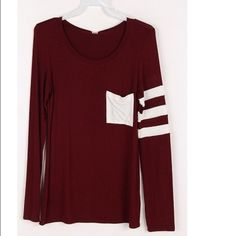 Varsity stripe long sleeve This is SO comfy! It's a beautiful burgundy with a white stripe detail on the sleeve. COMMENT BELOW WITH SOZE TO PURCHASE! :) Tops