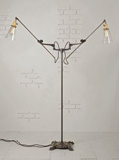 The Grand Ronde floor lamp. O.C. White design. Adjustable joints, generous wing span.