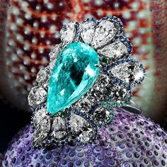 "ORLOV Jewellery. A fine ""piscine blue"" pear shape paraiba set with diamonds and blue sapphires  ring."