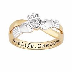'One Life, One Love' engraved Claddagh diamond ring. So pretty. -- if it was all silver, i would sooo get it!