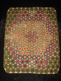 1900 Pennsylvania Penny Rug made of wool and homespun fabrics.It is handstitched with triple pennies with a nice graphic design and multi color fabrics through out.Has a flannel back. 25 in.by 32 in.  from antiques.com website