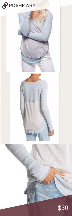 """$58 NEW Free People 'Friday Feelin Tee' $58 NEW Free People 'Friday Feelin Tee' in Blue/Gray ~Size S~  New without tags. Retails for $58 + Tax  Soft blue/gray tones Long sleeves Soft knit  Size S  Measures approximately: front length 26"""" back length  28"""" bust across 16"""" Cotton, polyester, rayon   High end department store shelf pull- new without tags. May have had customer contact  PRICED TO SELL FAST! PLEASE ASK ANY QUESTIONS BEFORE PURCHASE, THANKS CHECK OUT MY OTHER DESIGNER HANDBAGS AND…"""