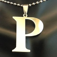 """Letter """"P"""" Pendant Super cute and perfect accessory for any outfit any season. Stainless steel. 1 inch long and comes on an 18 inch stainless steel chain. I'm sorry but I don't trade Jewelry Necklaces"""