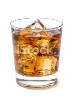 Whiskey on the Rock Buy this photo: http://www.istockphoto.com/photo/whiskey-on-the-rock-46656372?st=8116c5b