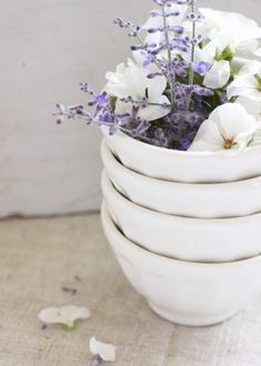 White bowls with lavender & white pansies
