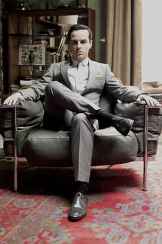 Moriarty in Sherlock's chair. Andrew Scott looks suitably mad, bad and dangerous...
