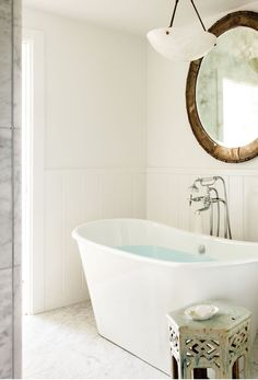 Jenni Kayne's Lake Tahoe Bathroom | white tub + circle mirror in a clean, all white bathroom