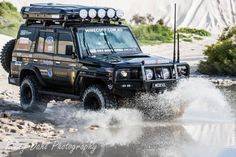 This fast tough looking 76 series Landcruiser wagon is known as the Black Knight and owned by a bloke called Anthony Collins and has be running 14 seconds on the quarter mile drag . Toyota Cruiser, Toyota Land Cruiser Prado, Porsche, Audi, Triumph Motorcycles, Ducati, Landcruiser 79 Series, Land Rover Discovery 2, Dodge