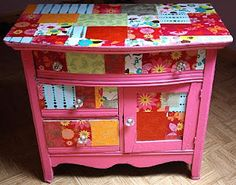 How fun is this? Decoupage, baby! I would love to redo the big bureau for Annika's room this way. I'm sure I have enough old scrapbook paper. Maybe I'll try the little table on the front porch first...