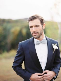 This dapper groom kept his (groomed) beard for the big day. We love this classic look. | photo: trent bailey | http://emmalinebride.com/groom/bearded-groomsmen/