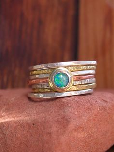 Hammered Stack Rings With Opal by KarenLutherJewelry on Etsy. $75.00 USD, via Etsy.