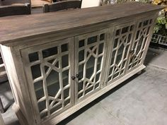 This cabinet is brand new made out of solid mahogany and hand painted in a light grey, distressed finish and dark wood top. This has shelves inside the glass doors. This is unique and I only have 1 available!! Amazing price for this and would be hundreds more in stores!!  Measurements: 71 wide, 17.5 deep, 38 high  I order wholesale from the manufacturer and have a small showroom in my warehouse in Bluffdale. All my items are close to half the price from buying in a store and great quality…