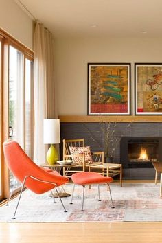 We love using orange in living rooms like this one, as it is such a bright, energizing color. Pumpkin spice and Persimmon are great paint colors! The color psychology of orange tells us it will improve communication and harmony in your space, bringing happiness. Learn how to incorporate orange into your home decor, in your living room, kitchen, dining room, bathroom, and other spaces. We also share popular combinations like orange and white, orange and blue. Hadley Court Interior Design…