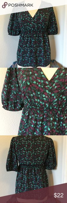 Ann Taylor LOFT Multi-colored blouse SZ SM Selling this Ann Taylor LOFT top. SZ SMALL This blouse has elastic and the waste line and at the end of the sleeves. This top is pre owned but very well taken care of and comes from a pet free home. Xoxo Ann Taylor Tops Blouses