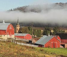 Lee farm, Coon Valley, WI., with the Upper Coon Valley Lutheran Church in the back gtound.