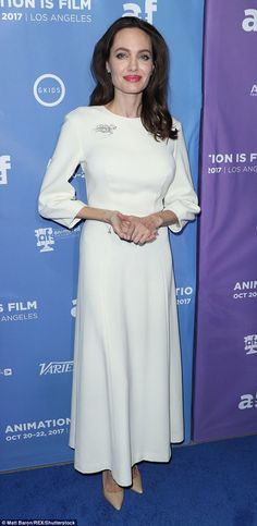 Vision in white: Angelina Jolie, 42, was spotted in a gorgeous gown in Los Angeles on Frid...