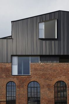The perfect blend of old and new - respecting the architecture that came before and creating something different for the end user to come.  Rust red meets slate gray.  Geometric meets organic.  Brick meets steel.  Thin glass meets thick.