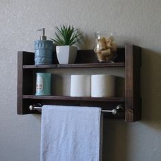 Handcrafted 2 tier bathroom shelf with a brushed nickel towel bar. Perfect for any home bathroom or apartment. Made from solid wood. It has been sanded