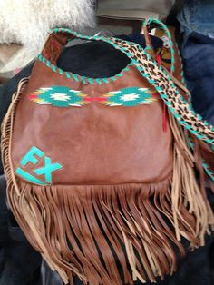 Awesome turquoise and brown leather fringe bag.