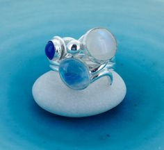 Silver Swirl Ring with Moonstone and Blue Agate  by MaryColyer