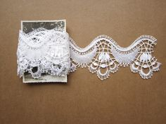 Traditional bobbin lace yards, cute design