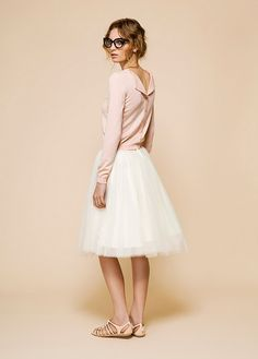 button-back sweater in ballet pink with tulle skirt and ... wait for it... hipster glasses. Love it!