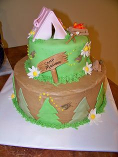 Trees and sign on side of cake