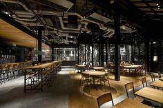 ร้านอาหารแนว Industry ที่ตกแต่งด้วยถังเบียร์และกาต้มน้ำจัดเรียงไว้ | fPdecor.com | ศูนย์รวมแบบบ้านฟรี และตกแต่งภายใน