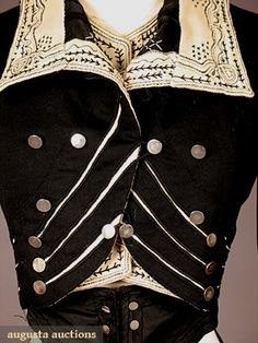 HIGH STYLED BLACK WOOL BODICE (detail 5), c. 1900 Black & cream wool felt w/ contrasting black & cream embroidery & soutache, silver military style buttons - Augusta Auctions