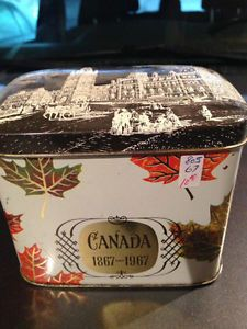 "Brooke Bond ""Canada 1867-1967"" tea tin ... commemorating Canada's centennial (100th anniversary), with maple leaf decoration and the Parliament Buildings in Ottawa on the hinged lid, chest shape, shades of brown w/ orange & gold, made in UK for Brooke Bond Canada Ltd., 1967"