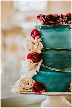 teal and gold wedding cake with roses | rustic wedding inspiration |This Inspo Boasts Poppin' Jewel Tones and Strong Architectural Lines #weddings #weddingcake #cake  #weddingcakes  #wedding  #weddingideas #weddinginspiration