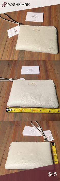 White COACH wristlet NWT!! Gorgeous small white coach wristlet. NWT. Gold hardware. Zipper closure. Dark brown interior with 2 card slots. 6in wide and 4in tall. Coach Bags Clutches & Wristlets